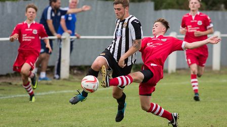 Swaffham's four-goal hero Joe Jackson in the thick of the action at the weekend. Picture: Eddie Dean