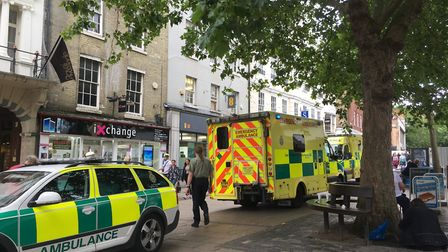 STAFF - Ambulance attend to a man who collapsed outside Norwich Market. Picture SABRINA JOHNSON