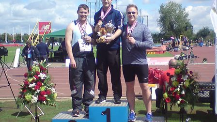 City of Norwich Athletic Club's Callum Brown, centre, after winning the men's hammer at the England