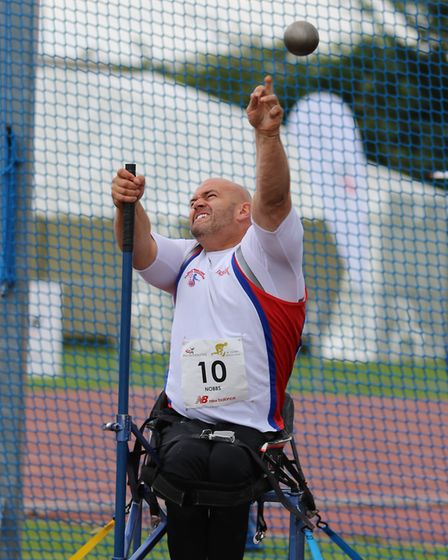 City of Norwich Athletic Club's Danny Nobbs on his way to winning gold in the seated shot put at the