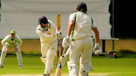 Sam Arthurton works the ball away as he moves towards a half century for Great Witchingham against B