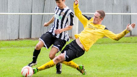 Swaffham Town Reserves' Korben Willis is too quick for his challenger. Picture: Eddie Deane