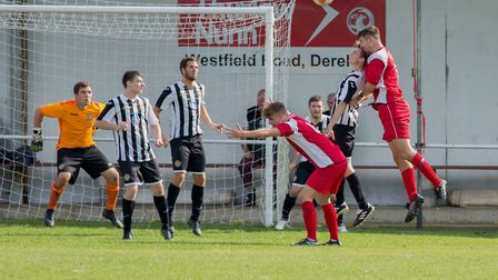 Liam Reed under aerial pressure during Swaffham Town's home defeat at the hands of early pacesetters