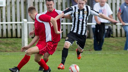 Ryan Pearson on the charge during his debut for Swaffham Town against Woodbridge. Picture: Eddie Dea