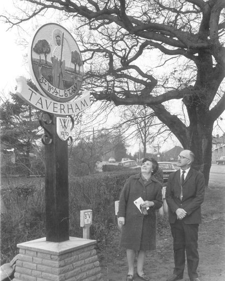 Taverham Village sign, which pictures the village's patron saint St. Walstan, is at the junction of