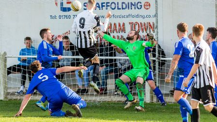 Swaffham Reserves' Matthew Blackford rises to head home at the weekend. Picture: Eddie Deane