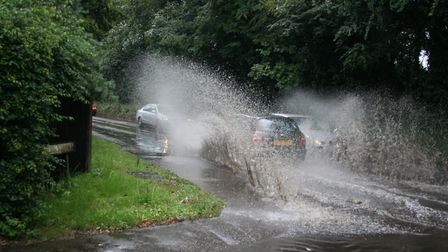 Flooding at Hellesdon Mill Lane junction with Hellesdon Road. Work is taking place around Hellesdon