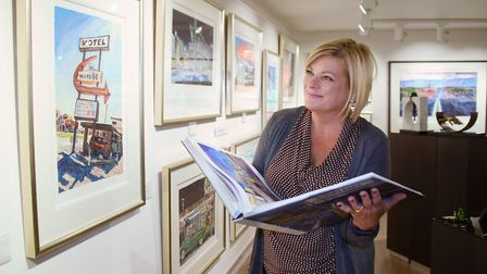 Tracey Jennings, manager at the Castle Fine Art Gallery, with the exhibition of work by Bob Dylan. P