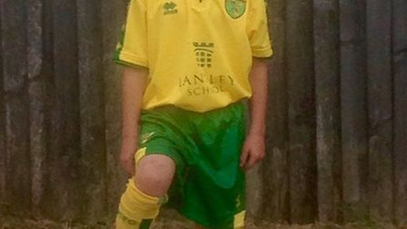 Alfie Reeve proudly wears the yellow and green of Norwich City. Picture: Family