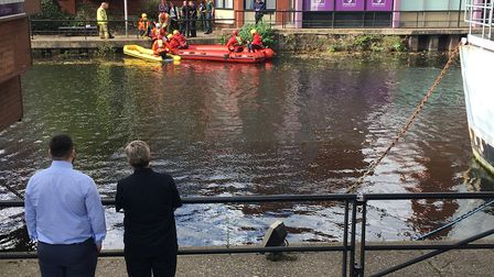 Emergency services personnel assist a woman from the River Wensum. Picture: ANDREW STONE