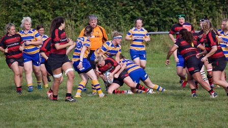 Wymondham Wasps' Amanda Jones takes ball into contact supported by team mates during an impressive h