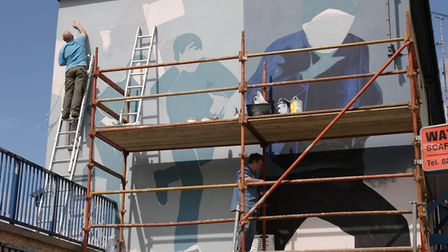 Artists at work on images featured in Art, Conflict & Remembering: the Murals of the Bogside Artists