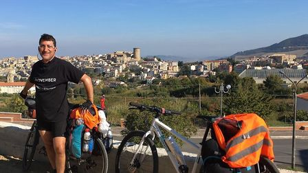Paul Strong, 55, from Norwich, pictured inTricarico in southern Italy, during his Movember cycle cha