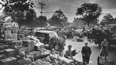 Norwich fruit and vegetable market bustling with activity. The market used the open city centre site