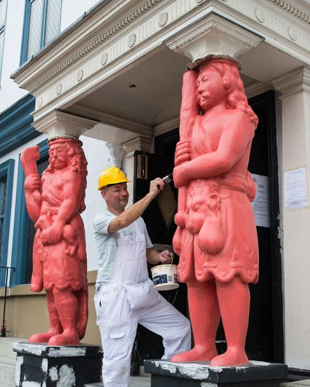 Decorator Chris Collins gives Samson & Hercules a makeover in salmon pink as an undercoat for their