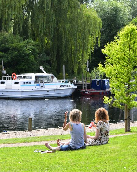 Relaxing in the warm weather at Thorpe River GreenPicture by SIMON FINLAY.