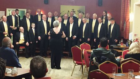 The Norwich Barbershop Singers performing at a function to raise money for charity. Picture: Courtes