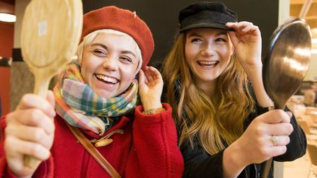 Florence Dennis and Sophie Anderson trying on hats at the Open venue Vintage Fair.Picture: Nick Butc