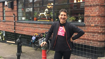 Paul Strong outside the Birdcage pub on Pottergate, Norwich, after cycling 2,000 miles in a month fr