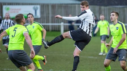 Swaffham Town's Joe Jackson in the thick of the action against Norwich CBS. Picture: Eddie Deane