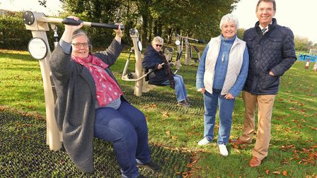 Alison Lys, front, and Bonnie Driver of the Hingham Playing Field Association try out the new fitnes