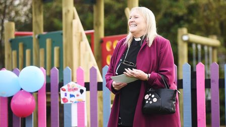 The new play area in Carbrooke is blessed by Revd Jane Atkins. Picture: Ian Burt