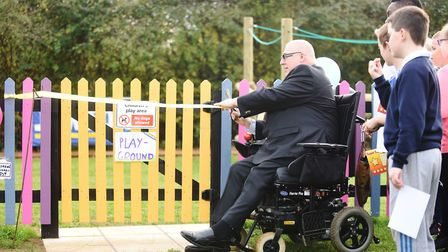 Phil Sampher officially opening the new play area in Carbrooke. Picture: Ian Burt