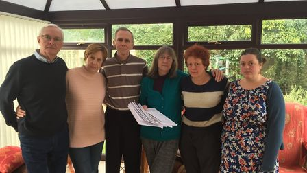 Jenny Smedley stands with fellow Necton residents holding a petition signed by almost half the house