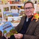 Author Douglas Vallgren with his third children's book about Rupert the Dinosaur, launched at the Gi
