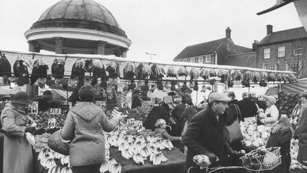 Swaffham's bustling traditional Saturday market, dominated by the Buttercross, March 1988. Photo: Ar