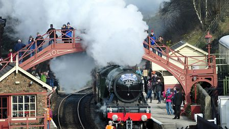 The Flying Scotsman steams through Goathland station, made famous in the Heartbeat TV series. Pictur
