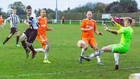 Alex Vincent looks on as Matthew Blackford blasts home his second goal of the afternoon. Picture: Ed