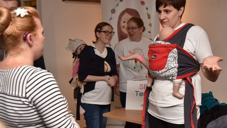 The Parent and Baby Show at Carrow RoadNatalie Marczewski demonstrates the baby slingsByline: Sonya