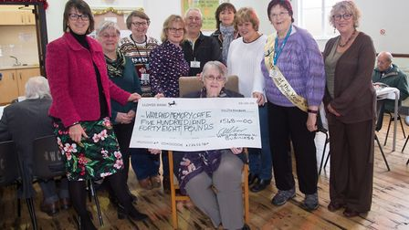 Wayland Women in Business members present a cheque to representatives from Wayland Memory Cafe. Pict
