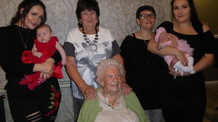 Peggy (seated) along with her daughter Betty Littlefield standing behind her, Betty's daughter Lesle