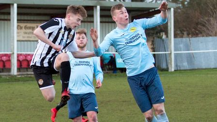 Swaffham Town's Nick Castellan goes up for a high ball during his side 2-0 home win over Debenham LC