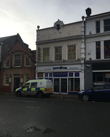 A Norfolk Police van outside the Courtesy Taxis base on Prince of Wales Road in Norwich after an ear