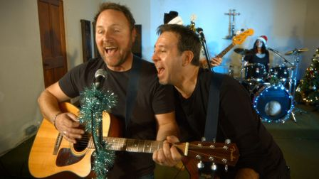 A still from the Fit For A King Christmas song. Rob Arneil (left) and John Fisher (right). Pic: Joh
