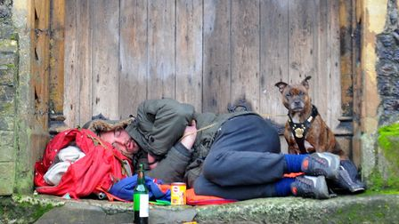 A man and his dog take refuge in the doorway of St John Maddermarket church back in 2015. Photo :Ste
