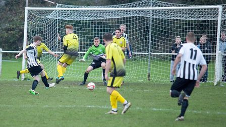 Nick Castellan fires home Swaffham Town's first of the afternoon in their 6-1 win over Wisbech St M