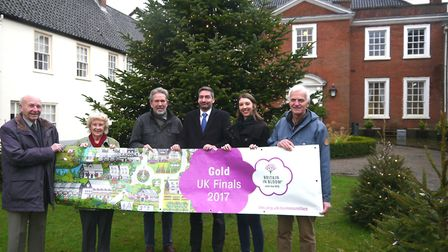 Michael King with some of the Norwich BID Team and Partners proudly holding this year's Gold Award B