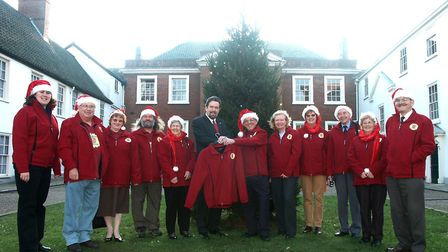 Michael King receiving his Norwich in Bloom red coat in December 2004 when he became the first Presi