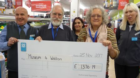 Mike Read, Dereham Co-op Manager (left), with John and Jackie Greenbrook, Museum 4 Watton trustees,