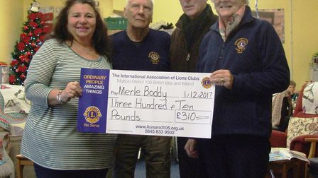 (L-R): Georgie Bell, from the Merle Boddy centre, Mike Stenning, Colin Mowles and Swaffham Lions Pre