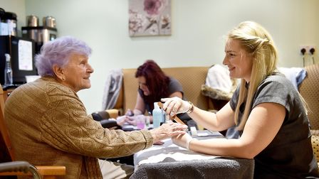 Residents at Whitehall Lodge Care Home, in Norwich, being treated to a beauty session by beauty ther