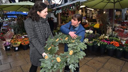Norwich Market - ten best things. Left, Finley Kidd with flower stall holder Charlene Cary.Picture: