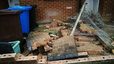 The wall at the front of Mrs Bilton's garden has been completely destroyed by the crash. Picture: Jo