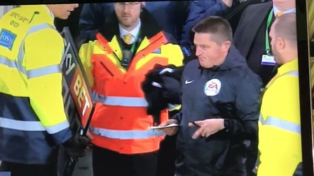David 'Spud' Thornhill comes out of the Carrow Road crowd to become the fourth official in the match