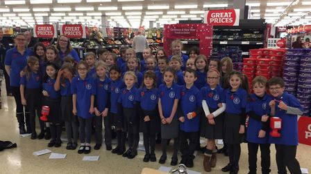 Little Plumstead Primary School choir performed war songs at the Pound Lane Sainsbury's in Thorpe Ha