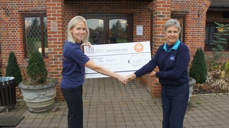 Georgina Finn, from The Feed (left) recieves a cheque from Pip Martin, chairwoman of Ladies Dunston